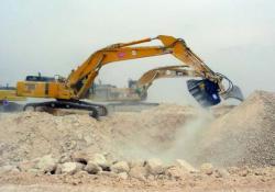Cupele concasoare ajută la constructia autostrăzii Hyderabad-Bangalore