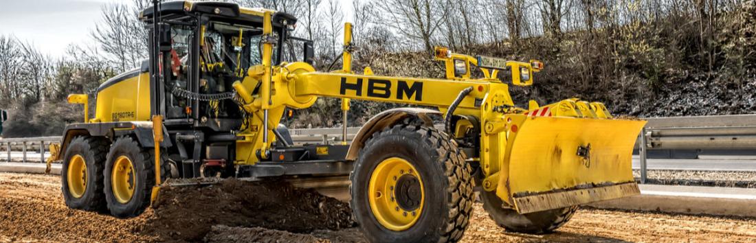 Autogrederele HBM-NOBAS: profesionalism la superlativ în ceea ce privește precizia lucrărilor de nivelare și de întreținere a drumurilor